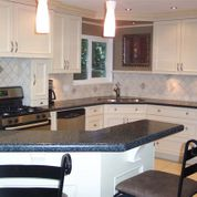 Solid Surface: Durable Countertops, Backsplashes & More in angley's Q.C. Designing Quality Cabinetry Inc.